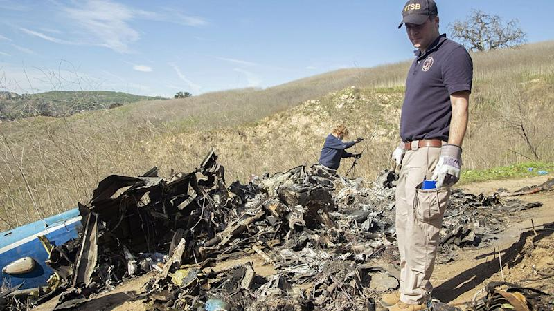 Investigators work at the scene of the helicopter crash that killed Kobe and Gianna Bryant. (Photo by James Anderson/National Transportation Safety Board via Getty Images)