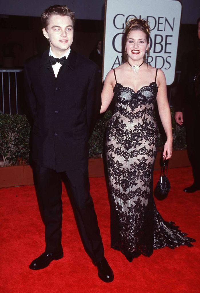 """<p>Dicaprio was 21 years old and Winslet, 22, when they filmed <i>Titanic</i>. Winslet <a href=""""https://www.google.com/search?q=winslet+marie+claire&oq=winslet+marie+claire&aqs=chrome..69i57j0l2.2719j0j4&sourceid=chrome&es_sm=119&ie=UTF-8#q=winslet+marie+claire+crazy+bloody+hours"""" rel=""""nofollow noopener"""" target=""""_blank"""" data-ylk=""""slk:later told Marie Claire"""" class=""""link rapid-noclick-resp"""">later told <i>Marie Claire</i></a> """"We needed each other to lean on, because we were very young and working all kinds of crazy, bloody hours, and it was a shock to the system."""" Both were nominated for Golden Globes for their roles and attended the ceremony together on January 18, 1998. (Photo: Getty Images)</p>"""