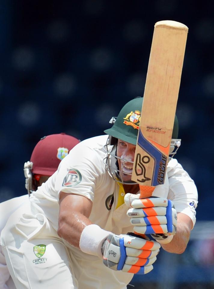Australian batsman Michael Hussey plays a shot during the final day of the second-of-three Test matches between Australia and West Indies April 19, 2012 at Queen's Park Oval in Port of Spain, Trinidad.