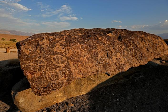 Geometric shapes, animals and human figures etched into the rocks at the Fish Slough Petroglyphs site.