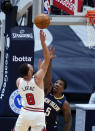 Chicago Bulls guard Zach LaVine (8) shoots over New Orleans Pelicans guard Eric Bledsoe (5) during the first half of an NBA basketball game in New Orleans, Wednesday, March 3, 2021. (AP Photo/Gerald Herbert)