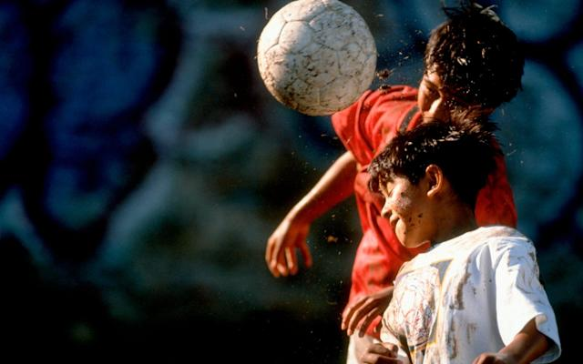 Brain-injury experts want to introduce an immediate ban on heading for children below the age of 18 - Photolibrary RM