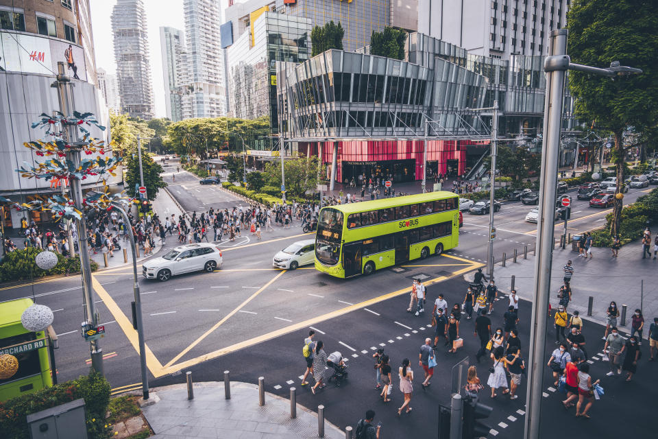 The Orchard Road crossing in Singapore is one of the busiest in the world, here seen an afternoon during the Covid-19 corona pandemics in October 2020. All people wearing masks to protect themselves.