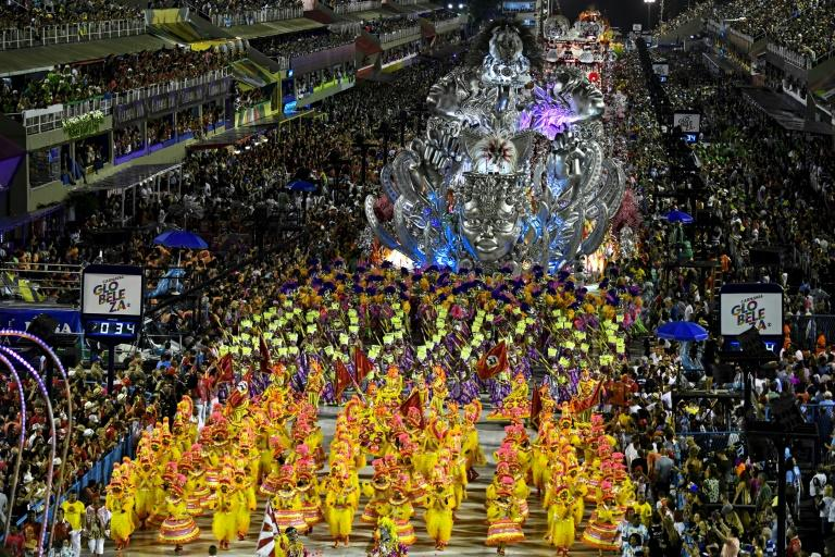 Members of the Viradouro samba school perform during the first night of Rio's carnival parade at the Sambadrome in Rio de Janeiro, Brazil, on February 23, 2020