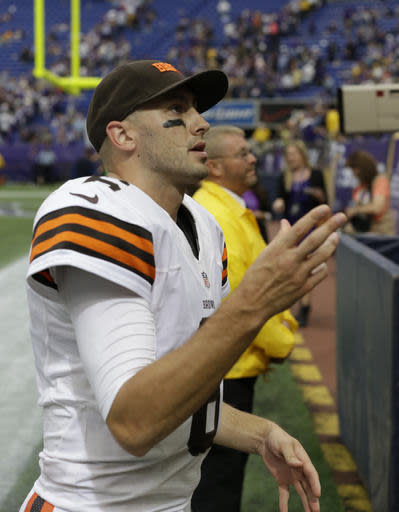 Cleveland Browns quarterback Brian Hoyer tosses a wrist band to fans after the Browns beat the Minnesota Vikings 31-27 in an NFL football game Sunday, Sept. 22, 2013, in Minneapolis. (AP Photo/Jim Mone)