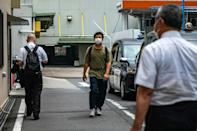Kawaguchi turns up for work at his taxi firm dressed in a baggy T-shirt and jeans