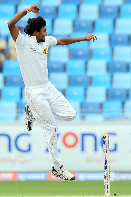 Sri Lankan bowler Suranga Lakmal celebrates the dismissal of Pakistan batsman Younis Khan during the fourth day of the second cricket Test match between Pakistan and Sri Lanka at the Dubai International Cricket Stadium in Dubai on January 11, 2014.  AFP PHOTO/Ishara S. KODIKARA