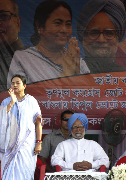 FILE - In this Friday, May 1, 2009 file photo, Trinamool Congress party leader Mamata Banerjee, left, gestures as Indian Prime Minister Manmohan Singh, right, attends an election campaign at Howrah, India. Manmohan Singh's coalition has splintered after Banerjee protested the decision to allow foreign retail chains to come into the country and demanded an immediate rollback or she would pull out of the coalition. But since pushing through a battery of unexpected economic reforms last week, and refusing to back down in the face of protests and political threats, Singh appeared to have rejuvenated a government thought hopelessly paralyzed. (AP Photo/Sucheta Das, File)
