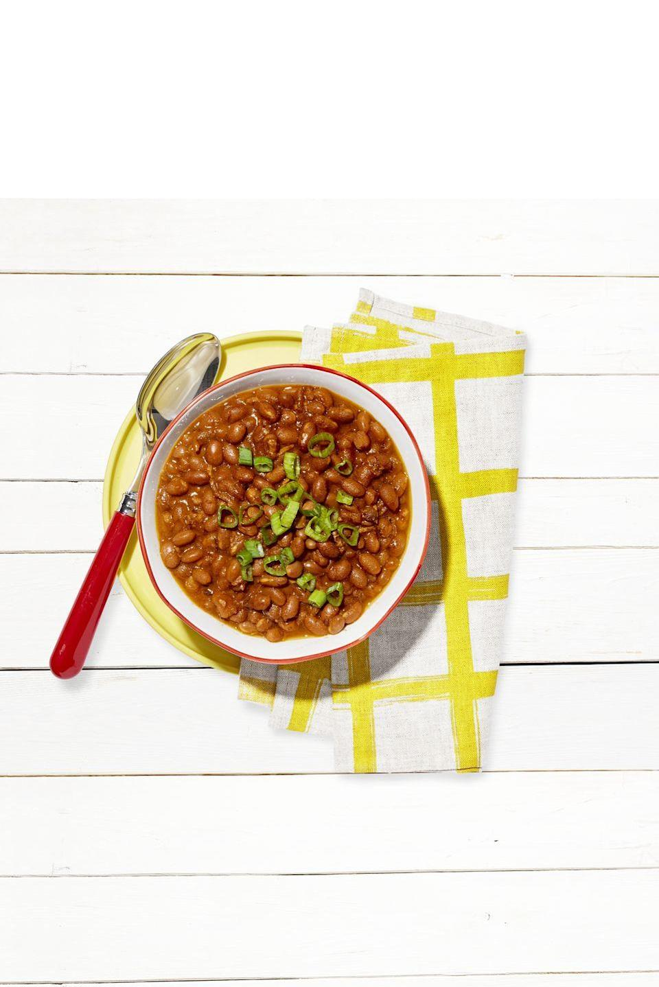 """<p>This hearty hands-off barbecue side dish practically makes itself. </p><p><strong><a href=""""https://www.countryliving.com/food-drinks/a36742540/slow-cooker-baked-beans-recipe/"""" rel=""""nofollow noopener"""" target=""""_blank"""" data-ylk=""""slk:Get the recipe"""" class=""""link rapid-noclick-resp"""">Get the recipe</a>.</strong></p>"""