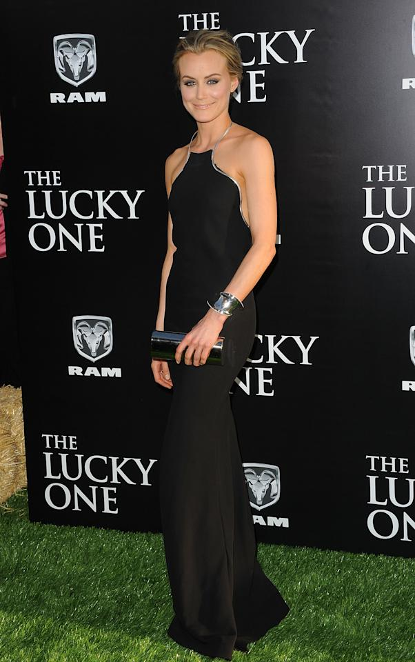 HOLLYWOOD, CA - APRIL 16:  Actress Taylor Schilling arrives at the premiere of Warner Bros. Pictures' 'The Lucky One' held at Grauman's Chinese Theatre on April 16, 2012 in Hollywood, California.  (Photo by Jason Merritt/Getty Images)