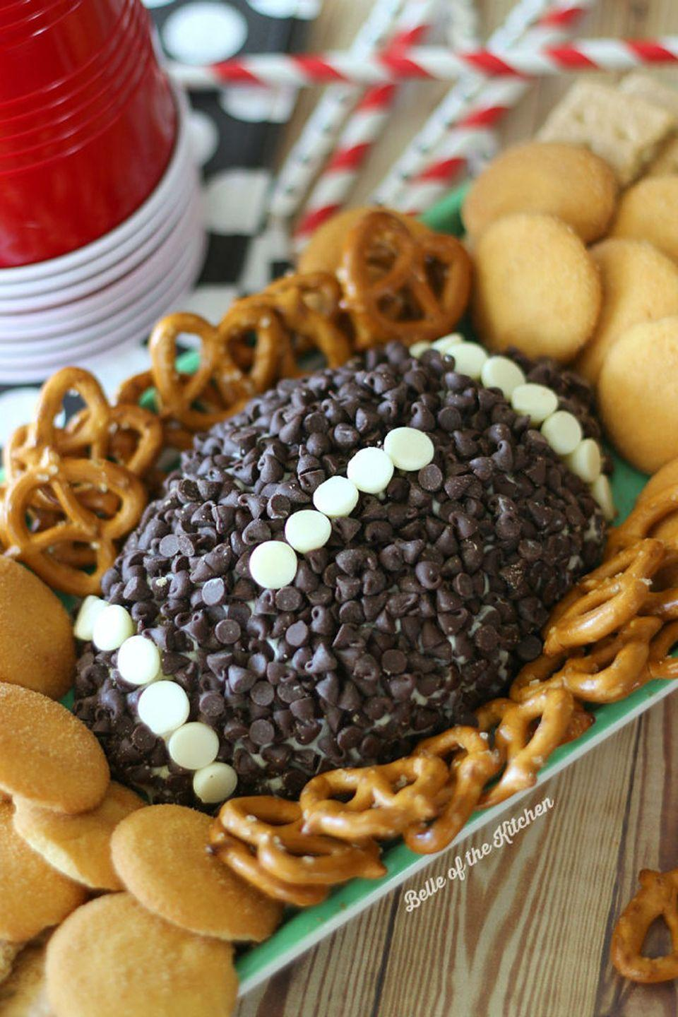 """<p>This dessert dip will have the whole party cheesin'.</p><p><strong>Get the recipe at <a href=""""https://belleofthekitchen.com/2014/10/28/game-day-chocolate-chip-cheesecake-ball/"""" rel=""""nofollow noopener"""" target=""""_blank"""" data-ylk=""""slk:Bell of the Kitchen"""" class=""""link rapid-noclick-resp"""">Bell of the Kitchen</a>.</strong></p>"""