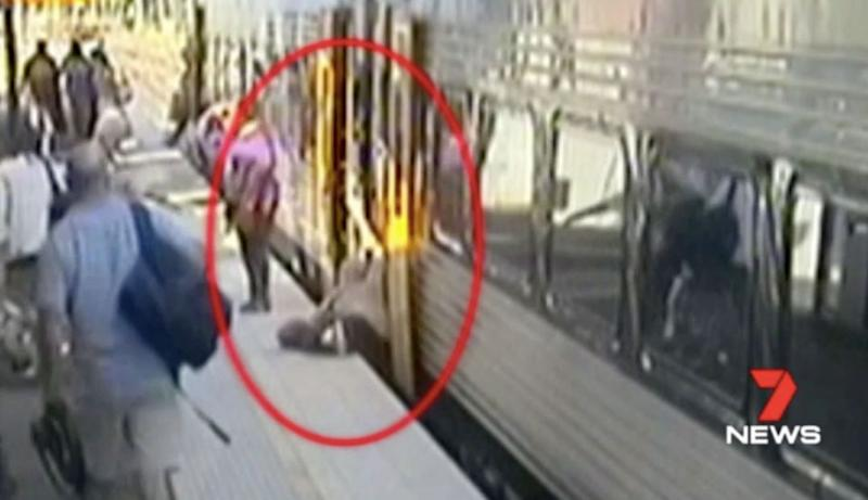 This woman steps off a train and falls through the gap. Source: 7 News