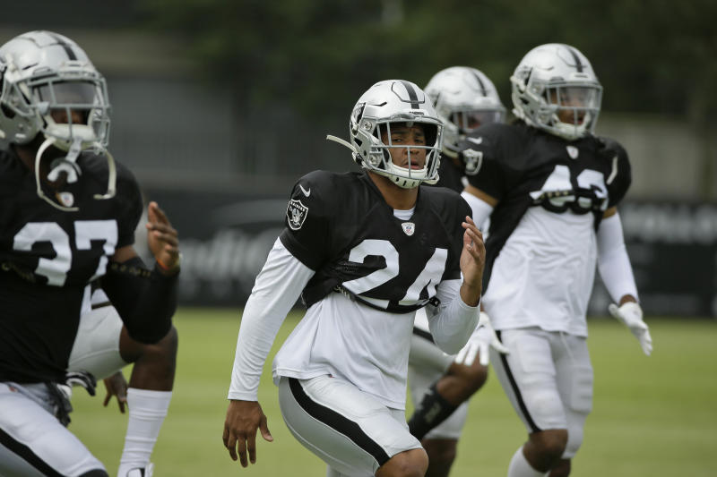 Oakland Raiders defensive back Johnathan Abram stretches during NFL football training camp Monday, July 29, 2019, in Napa, Calif. (AP Photo/Eric Risberg)
