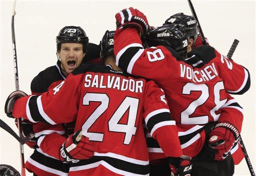 New Jersey Devils' Bryce Salvador celebrates with teammates after scoring a goal in the second period during Game 5 of the NHL hockey Stanley Cup finals, Saturday, June 9, 2012, in Newark, N.J.. (AP Photo/Frank Franklin II)