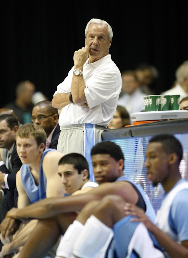 """North Carolina head coach Roy Williams watches as his team scrimmages at """"Late Night With Roy,"""" a kickoff to the college basketball season in Chapel Hill, N.C. on Friday, Oct. 25, 2013. (AP Photo/Nell Redmond)"""