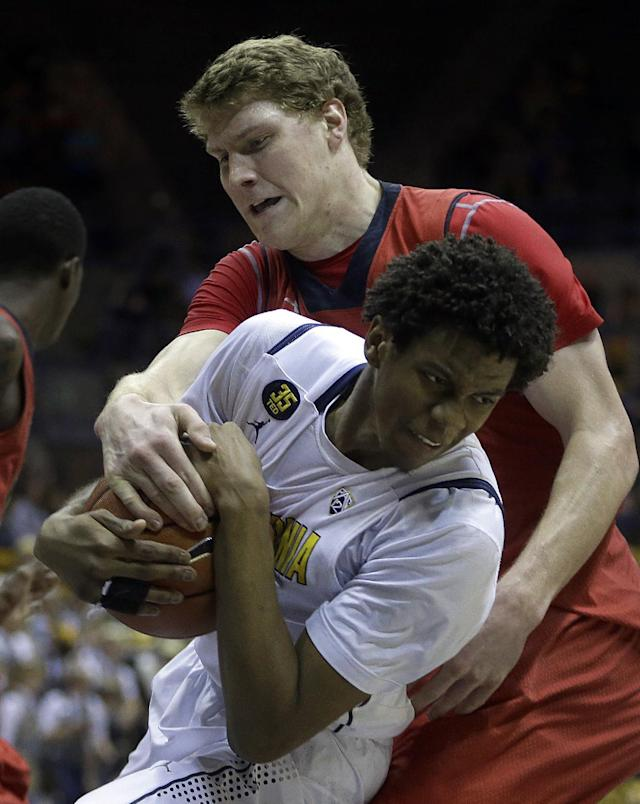 Utah's Dallin Bachynski attempts to strip the ball from California's Tyrone Wallace in the first half of an NCAA college basketball game Wednesday, March 5, 2014, in Berkeley, Calif. (AP Photo/Ben Margot)