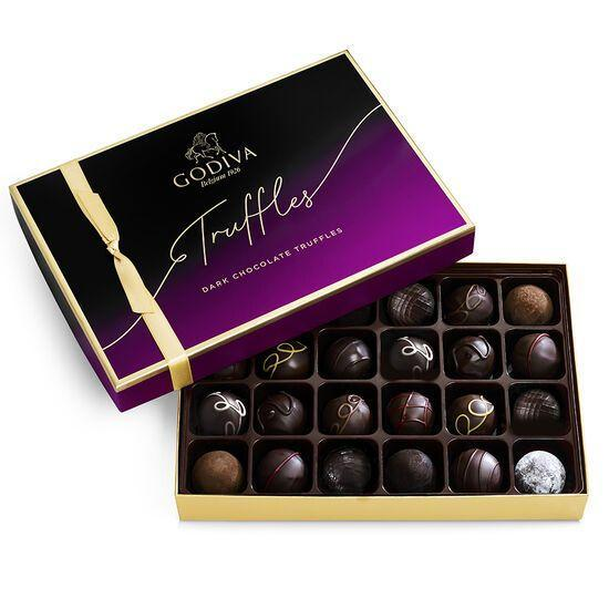 """<p><strong>Godiva</strong></p><p>godiva.com</p><p><strong>$49.95</strong></p><p><a href=""""https://go.redirectingat.com?id=74968X1596630&url=https%3A%2F%2Fwww.godiva.com%2Fdark-chocolate-truffles-24-pc%2F14229.html&sref=https%3A%2F%2Fwww.redbookmag.com%2Flife%2Fg35374113%2Fvalentines-day-gifts-for-anyone%2F"""" rel=""""nofollow noopener"""" target=""""_blank"""" data-ylk=""""slk:Shop Now"""" class=""""link rapid-noclick-resp"""">Shop Now</a></p><p>Obviously, there had to be a box of chocolates on the list and nobody does chocolate like Godiva. This box of 24 truffles is as decadent as it gets and will absolutely score you some points with your partner, no matter how far along your relationship is.</p>"""