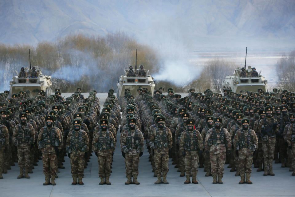 TOPSHOT - This photo taken on January 4, 2021 shows Chinese People's Liberation Army (PLA) soldiers assembling during military training at Pamir Mountains in Kashgar, northwestern China's Xinjiang region. (Photo by STR / AFP) / China OUT (Photo by STR/AFP via Getty Images)