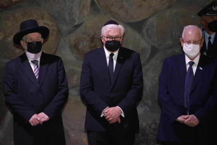 German President Frank-Walter Steinmeier, center, stands with Israel's President Reuven Rivlin, right, and Rabbi Yisrael Meir Lau during a visit to the Hall of Remembrance at the Yad Vashem Holocaust memorial in Jerusalem, Thursday, July 1, 2021. (AP Photo/Ariel Schalit)