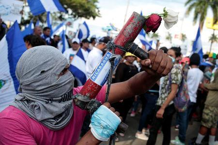 A protester poses with his homemade mortar during a protest against President Daniel Ortega's government in Managua, Nicaragua May 30, 2018. REUTERS/Oswaldo Rivas