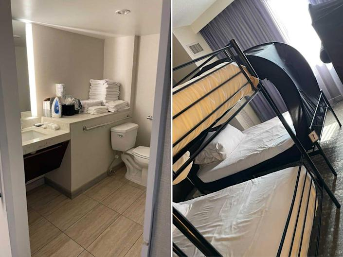 There's a typical hotel bathroom with a shower and toilet and familiar white, crisp sheets.