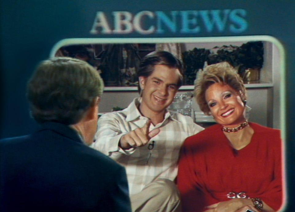 """Andrew Garfield, left, and Jessica Chastain re-create a famous interview with the Bakkers in """"The Eyes of Tammy Faye."""""""