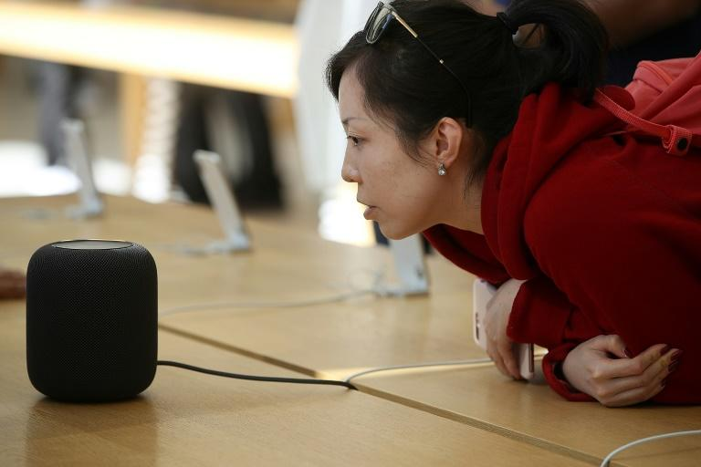 Concerns over privacy and data protection could cloud the outlook for digital assistants which are built into devices like the Apple HomePod (AFP Photo/JUSTIN SULLIVAN)