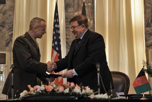 Afghanistan's Defence Minister Abdul Rahim Wardak (R) shakes hands with US commander in Afghanistan, General John Allen