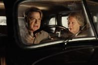 """Eddie Izzard, left, and Judi Dench appear in a scene from """"Six Minutes to Midnight."""" (Amanda Searle/IFC Films via AP)"""