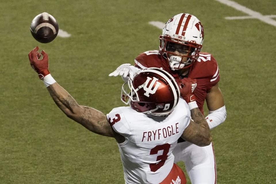 Wisconsin cornerback Caesar Williams breaks up a pass intended for Indiana's Ty Fryfogle during the second half of an NCAA college football game Saturday, Dec. 5, 2020, in Madison, Wis.Indiana won 14-6. (AP Photo/Morry Gash)