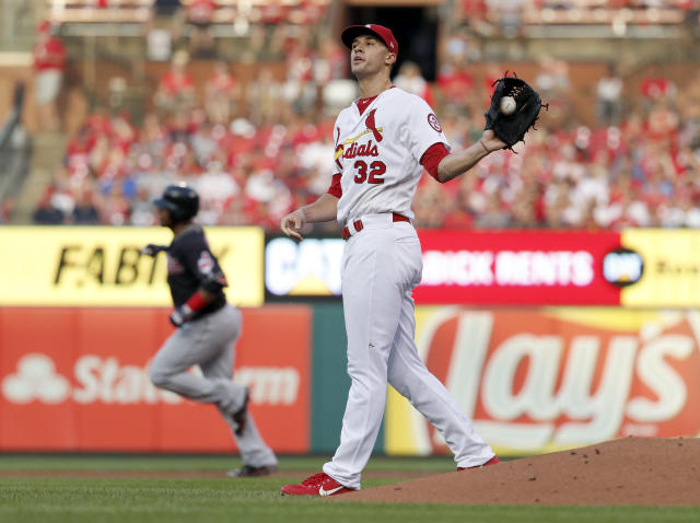 St. Louis Cardinals starting pitcher Jack Flaherty (32) gets a new ball as Cleveland Indians' Edwin Encarnacion rounds the bases after hitting a solo home run during the second inning of a baseball game Wednesday, June 27, 2018, in St. Louis. (AP Photo/Jeff Roberson)