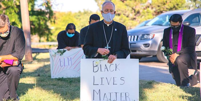 Bishop Mark Seitz takes the knee at a Black Lives Matter rally in El Paso, Texas, on June 1, 2020.