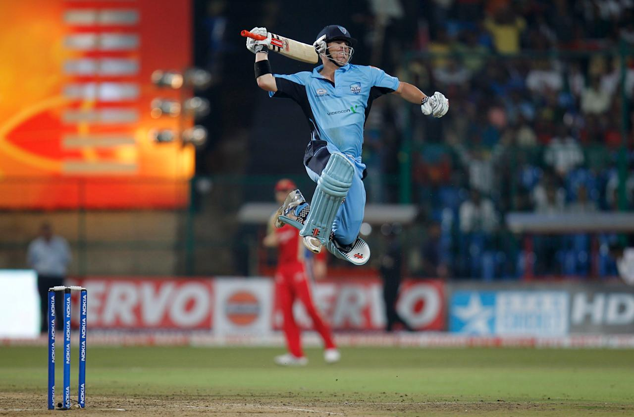 BANGALORE, INDIA - OCTOBER 7: New South Wales batsman, David Warner, jumps in the air as he celebrates his century during the Champions League Twenty20 Semi Final match between New South Wales Blues v Royal Challengers Bangalore at M. Chinnaswamy Stadium on October 7, 2011 in Bangalore, India.   (Photo by Vijayanand Gupta/Hindustan Times via Getty Images)