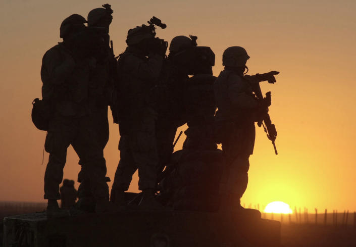 FILE - In this Jan. 14, 2002 file photo, U.S. Marines scan the northwest perimeter of the American military compound at Afghanistan's Kandahar airport using sophisticated thermal imagery equipment. The Biden administration's surprise announcement in April 2021, of an unconditional troop withdrawal from Afghanistan by Sept. 11, 2021, appears to strip the Taliban and the Afghan government of considerable leverage, pressuring them to reach a peace deal. (AP Photo/Marco Di Lauro, File)