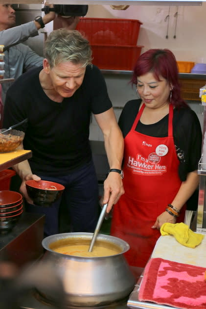 Gordon Ramsay gets to know more about 328 Katong Laksa's dish from founder Lucy Koh. (Yahoo! photo/Catherine Ling)