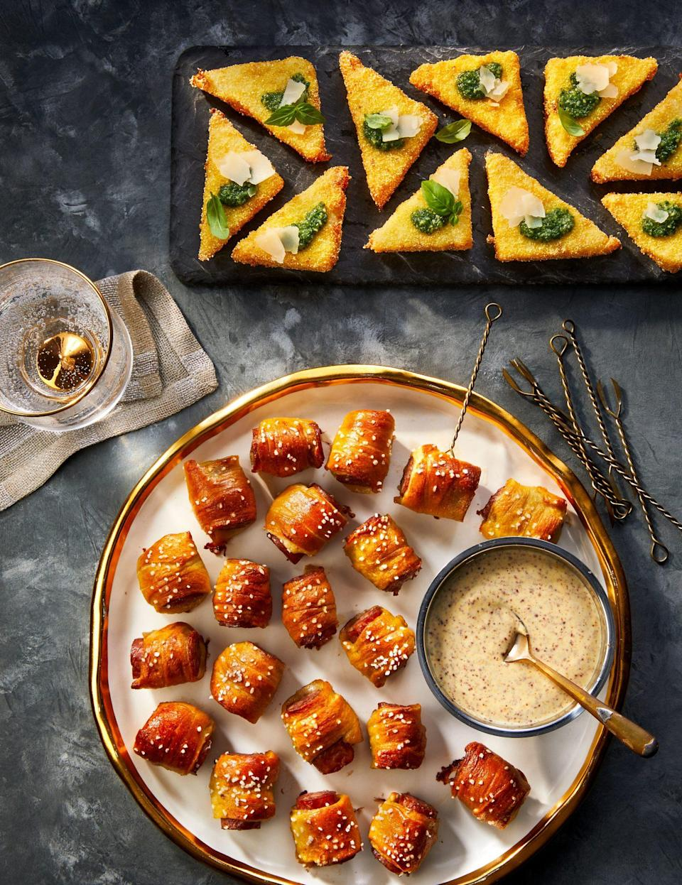 """<p><strong>Recipe: <a href=""""https://www.southernliving.com/recipes/smoked-sausage-pretzel-bites"""" rel=""""nofollow noopener"""" target=""""_blank"""" data-ylk=""""slk:Smoked Sausage Pretzel Bites"""" class=""""link rapid-noclick-resp"""">Smoked Sausage Pretzel Bites</a></strong></p> <p>Prepared pizza dough and spicy smoked sausage come together to create pretzel bits that are packed with flavor in every bite. <br></p>"""