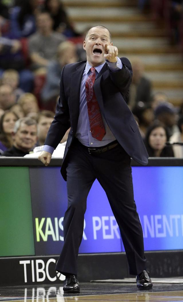 Sacramento Kings head coach Michael Malone shouts out instructions to his team during the fourth quarter against the Denver Nuggets in a NBA basketball game in Sacramento, Calif., Sunday, Jan. 26, 2014. The Nuggets won 125-117.(AP Photo/Rich Pedroncelli)