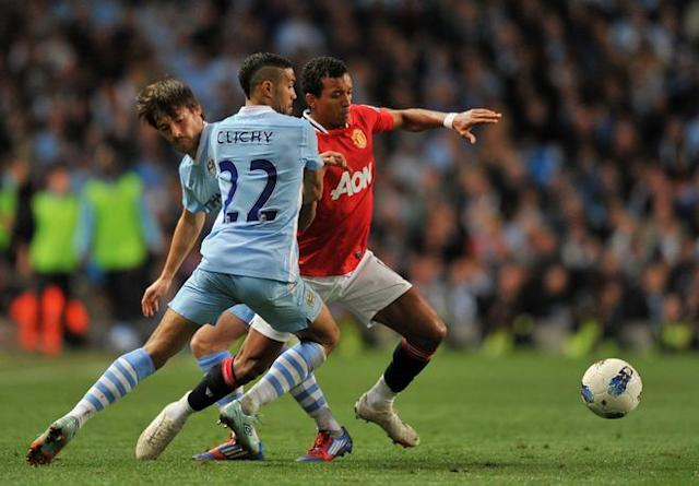 "Manchester United's Portuguese midfielder Nani (R) vies for the ball against Manchester City's Spanish footballer David Silva (L) and Manchester City's French footballer Gael Clichy (C) during their English Premier League football match at The Etihad stadium in Manchester, north-west England on April 30, 2012. AFP PHOTO/PAUL ELLIS RESTRICTED TO EDITORIAL USE. No use with unauthorized audio, video, data, fixture lists, club/league logos or ""live"" services. Online in-match use limited to 45 images, no video emulation. No use in betting, games or single club/league/player publications.PAUL ELLIS/AFP/GettyImages"