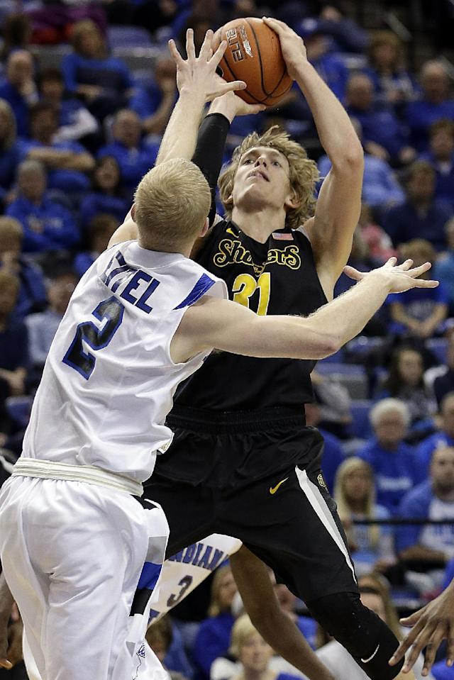 Wichita State guard Ron Baker (31) shoots over Indiana State guard Lucas Eitel (2) during the first half of an NCAA college basketball game in Terre Haute, Ind., Wednesday, Feb. 5, 2014. (AP Photo/AJ Mast)