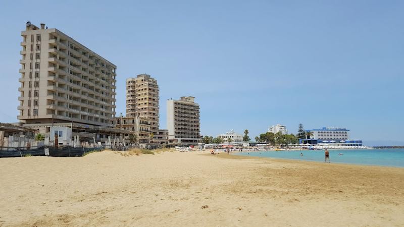 Abandoned hotel buildings stand next to public beach inside the 'Forbidden Zone' of Varosha.
