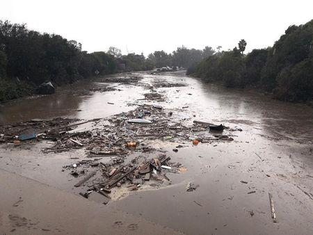 Debris floats in flooded waters on the freeway after a mudslide in Montecito, California, U.S. in this photo provided by the Santa Barbara County Fire Department, January 9, 2018.   Mike Eliason/Santa Barbara County Fire Department/Handout via REUTERS