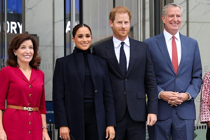 """<p>They posed for a photo with Governor Hochul and Mayor De Blasio. </p><p><strong>MORE</strong>: <a href=""""https://www.townandcountrymag.com/society/tradition/a37705465/meghan-markle-black-suit-outfit-new-york-photos/"""" rel=""""nofollow noopener"""" target=""""_blank"""" data-ylk=""""slk:Meghan Markle Wore a Chic Black Suit During Her New York Visit"""" class=""""link rapid-noclick-resp"""">Meghan Markle Wore a Chic Black Suit During Her New York Visit</a></p>"""