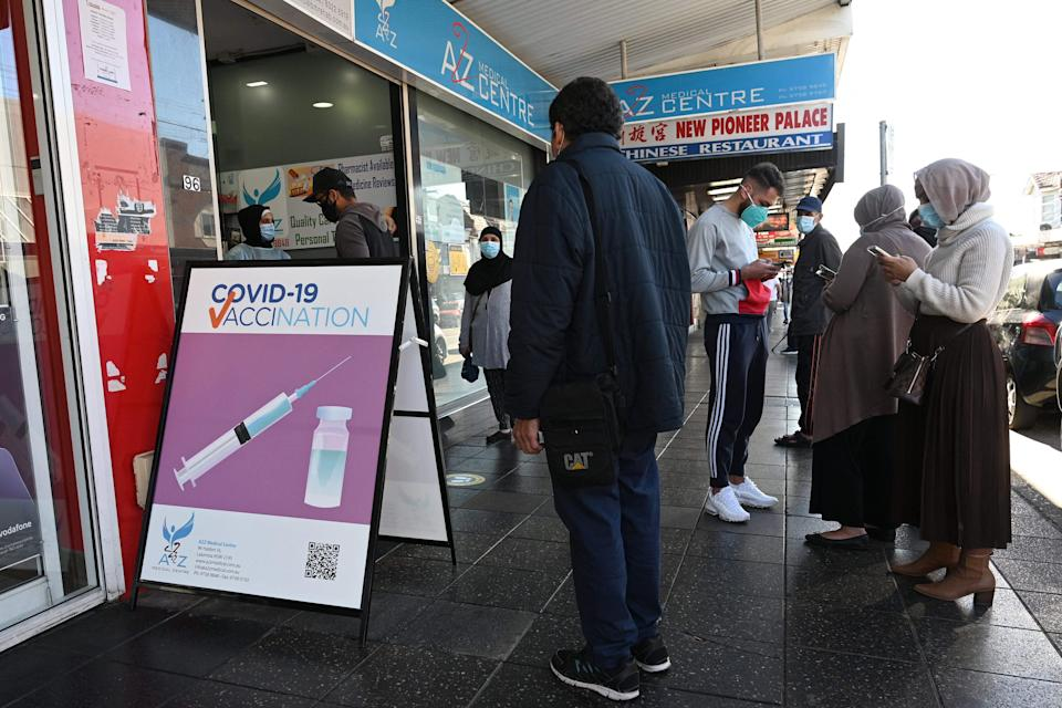 Residents queue up outside a pharmacy for a Covid-19 vaccination in western Sydney (AFP via Getty Images)
