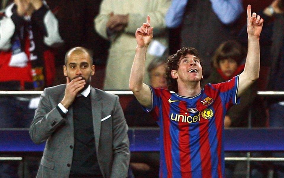 Barcelona's Lionel Messi (R) celebrates in front of his coach Pep Guardiola after scoring a goal against VfB Stuttgart - Reuters