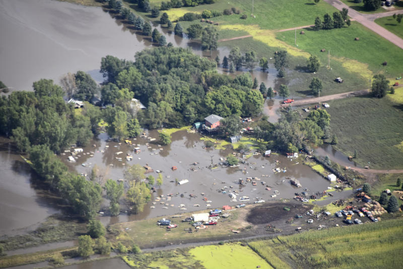 RETRANSMISSION TO ADD LOCATION OF SPENCER SD - This Saturday, Sept. 14, 2019 photo provided by the South Dakota Civil Air Patrol shows an aerial view of the flooding in Spencer, S.D. Flooding from torrential rain that's soaked much of southeastern South Dakota has closed schools for a second day, submerged city streets and caused some to evacuate their homes.  (South Dakota Civil Air Patrol via AP)