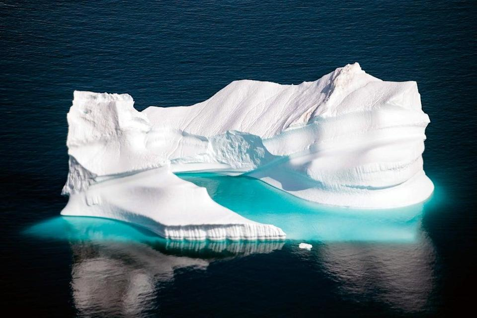 An iceberg floats along the eastern cost of Greenland near Kulusuk (AFP via Getty Images)