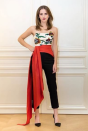 <p>Laura Kim and Fernando Garcia, the new co-creative directors of Oscar de la Renta, created this Jacobian flower-embroidered duchesse satin bustier with an organic silk faille sash and organic wool trousers as part of their first collection. Emma wore it to the first public 'Beauty and the Beast' screening in Paris.<em> [Photo: Instagram/The Press Tour]</em> </p>