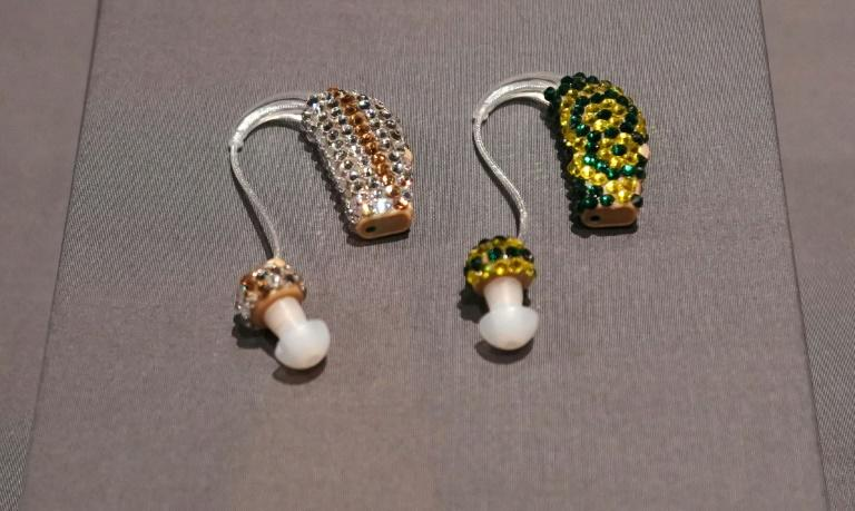 Bedazzled and Bejeweled Earring Aids, making a fashion statement, are displayed as part of the exhibit