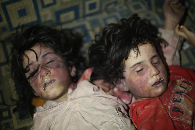 <p>Dead bodies of Syrian kids are seen after Assad regime forces allegedly conducted poisonous gas attack to Douma town of Eastern Ghouta in Damascus, Syria on April 8, 2018. (Photo: Halil el-Abdullah/Anadolu Agency/Getty Images) </p>