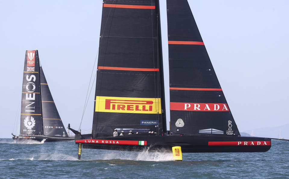 Italy's Luna Rossa, right, leads Britain's INEOS Team UK in race eight of the Prada Cup on Auckland's Waitemata Harbour, New Zealand, Sunday, Feb.21, 2021.Italian challenger Luna Rossa Prada Pirelli will race defender Emirates Team New Zealand in the 36th match for the America's Cup after beating Britain's Ineos Team UK in two races Sunday to seal a 7-1 win in the best-of-13 race challengers series final. (Brett Phibbs/NZ Herald via AP)